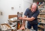 Donald Slater cracks open a geode for a customer at his store, Nature's Gallery, on July 1, 2014 in Carrollton, Texas. (Matt Garnett / The Talon News)