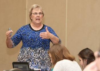 Margaret Sorrows teaches about reporting at the Gloria Shields All-American Workshop in Dallas July 1. Photo by Clint Smith